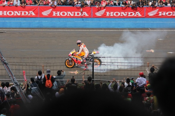 Marquez burning out MotoGP machine in Indonesia for first time 2014
